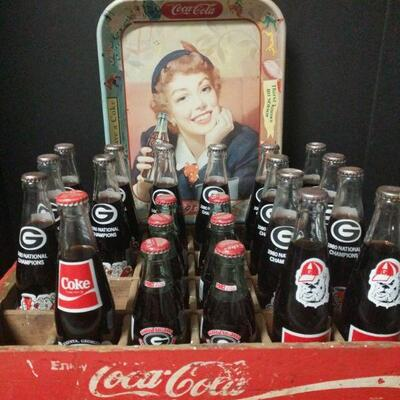 A combination of two great things, Coke and Georgia!! 13 full bottles of the 1980 National Champions, 2 full bottles of the 1985...