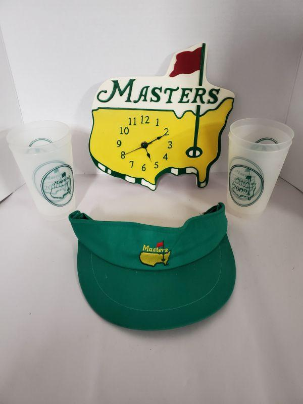 """Masters wooden clock measures 10x10"""", Masters visor and 4 plastic cups from 2009 and 2010.  https://ctbids.com/#!/description/share/768457"""
