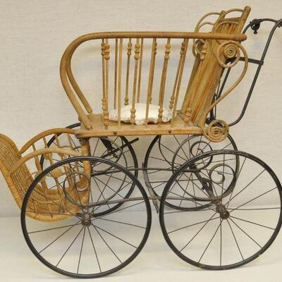 Vintage wicker baby carriage (perambulator)