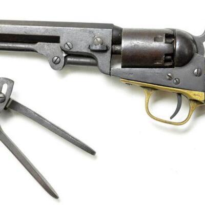 Colt Model 1849 pocket revolver with bullet mold