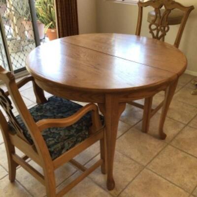Table has 2 leaves but only 2 chairs