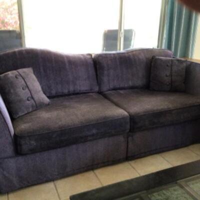 Purple sofa and loveseat