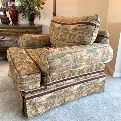 Oversized upholstered chair in elephant print is 39