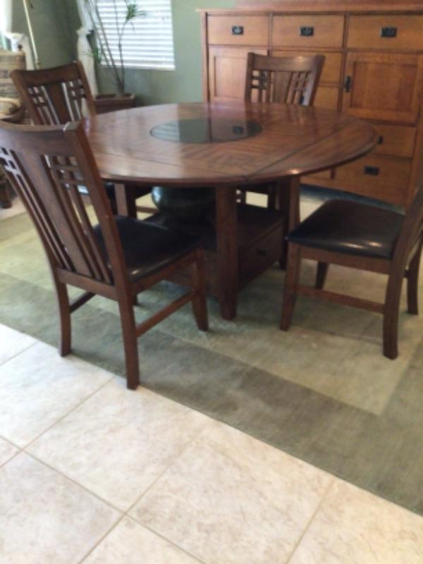 Mission style dining table has built in Lazy Susan. Also available matching buffet cabinet