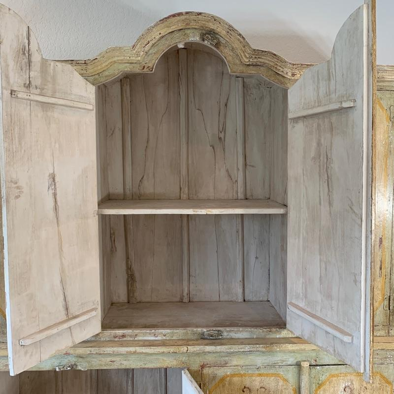 """Hand painted distressed 2PC imported cabinet. Bottom piece measures 72"""" wide and 36.5"""" high. Top piece measures 69"""" wide and 51"""" high. Overall height 87.5"""""""