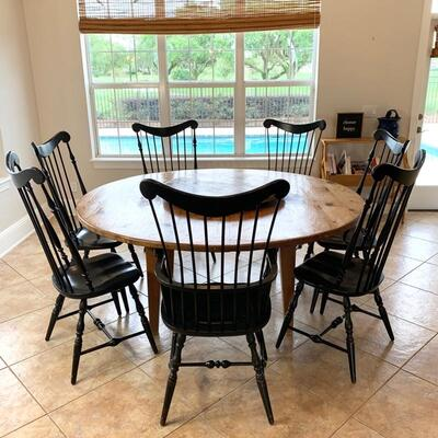 Round waxed pine custom table (with removable lazy-suzan) shown with vintage fan-back Windsor chairs. The custom table has a beautiful...