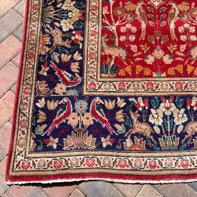 Vintage rug measures 82