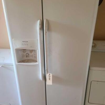 2104  Frigidaire Refrigerator Measures Approx: 36