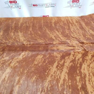 15: 	  NEW Large Brazilian Brindle hair on cowhide rug. Measures approximately 38-46 square feet. Large Brazilian Brindle hair on cowhide...