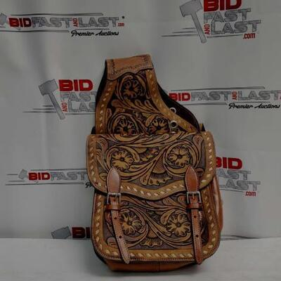21	  Tooled leather saddle bag. Tooled leather saddle bag. This saddle bag features floral tooled leather and comes equipped with front D...