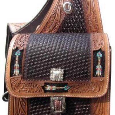 22  Basket weave and leaf tooled leather saddle bag with beaded arrow inlay. Basket weave and leaf tooled leather saddle bag. This...