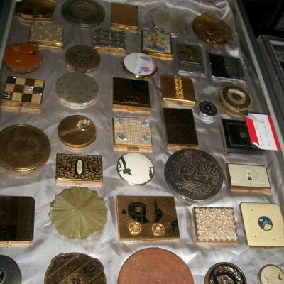 Large collection of vintage compacts.