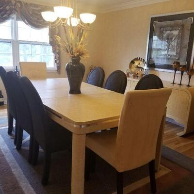 Contemporary dining room table (fiberglass mesh overlay) with 2 leaves and 8 chairs.