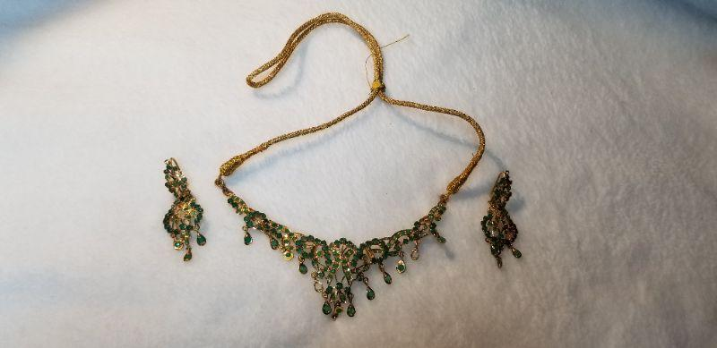 22k gold with emeralds