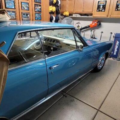 Light blue 1965 Pontiac GTO