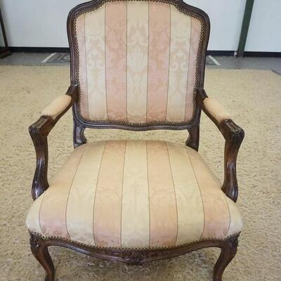 1010FRENCH PROVINCIAL CARVED UPHOLSTERED ARM CHAIR