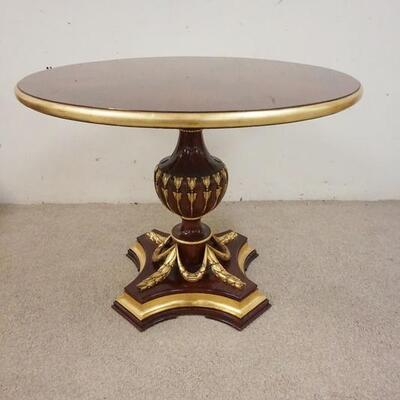1004MAHOGANY TABLE ON URN SHAPED PEDESTAL HAS CARVED SWAG W/ GILT ACCENTS. 40 IN X 30 IN