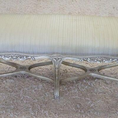 1011UPHOLSTERED WINDOW BENCH W/GILT SILVER FINISH ON CARVED WOOD, SOME STAINING ON UPHOLSTERY, 43 1/2 IN X 16 IN X 19 IN HIGH
