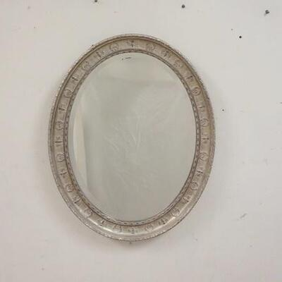 1018BEVELED GLASS MIRROR IN GILT & EMBOSSED SILVER FRAME. 22 IN X 28 IN.