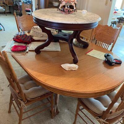 Marble top coffee table and a round oak dining table