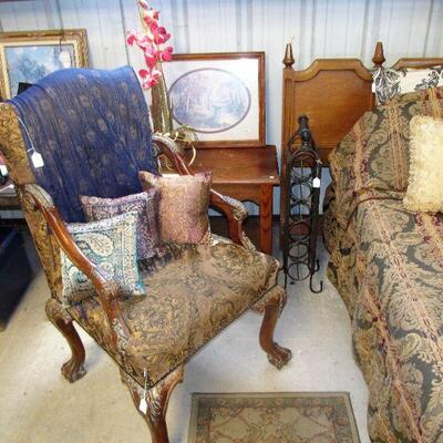 Mid-century king headboard, elegant armchair with rich tapestry-like upholstery