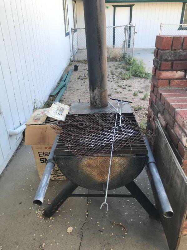 Large smoker and smaller electric smoker in original box