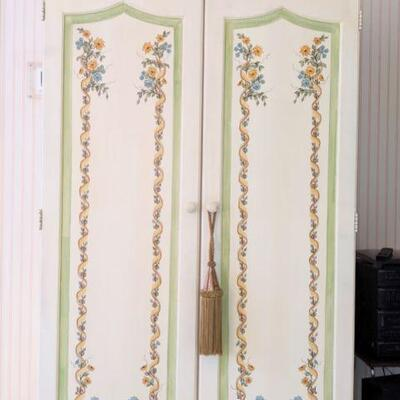 Entertainment armoire, holds tvs, stereo, books etc hand-painted. Doors reticulate fold back against the sides.