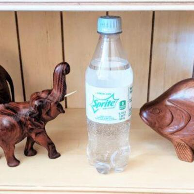 Pair of hand-carved elephants and fish, Sprite bottle to show size