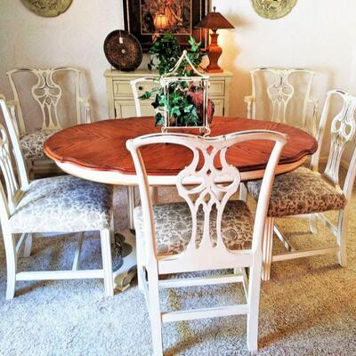 Lovely oval dining table. Has two leaves for extension and six chairs. Shabby chic at its best