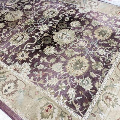 Beautiful lazy boy area rug. Colors are purple and tan, approximately 6x9