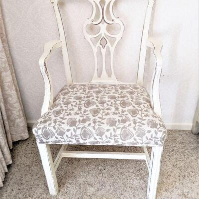 One of two armchairs matching table