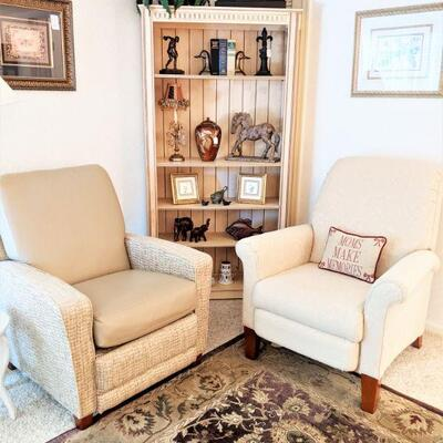 Pair of lazy boy recliners one is upholstered the other has upholstery and leather. Beautiful bookcase w/accessories