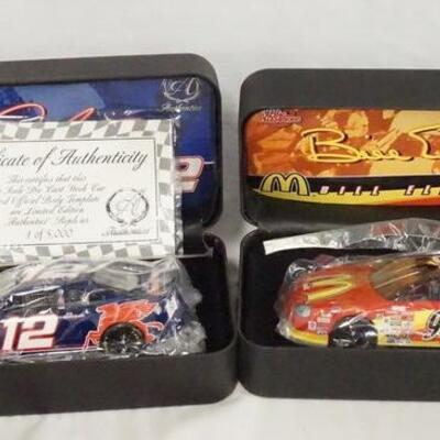 1073LOT OF TWO RACING CHAMPIONS *AUTHENTICS* LIMITED EDITION 1:24 SCALE MODEL CARS IN CASES.