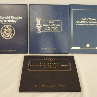 1057LOT OF FOUR COMMEMORATIVE STAMP COLLECTIONS. LOT INCLUDES THE 1893 CHRISTOPHER COLUMBUS STAMPS, U.S. PHILATELIC PANORAMAS, 1987...
