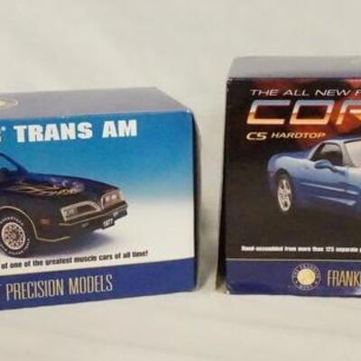 1014LOT OF TWO FRANKLIN MINT PRECISION 1:24 SCALE MODEL CARS IN ORIGINAL BOXES. LOT INCLUDES A 1977 PONTIAC TRANS AM & A CORVETTE C5...