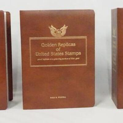 1028LOT OF THREE GOLDEN REPLICAS OF THE UNITED STATES STAMP ALBUMS. ALBUMS CONTAIN FIRST DAY COVERS W/ GOLDEN REPLICA STAMPS ALONG W/...