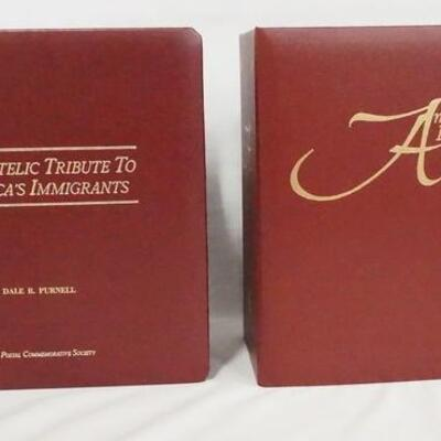 1056LOT OF TWO COMMEMORATIVE STAMP ALBUMS; A PHILATELIC TRIBUTE TO AMERICAS IMMIGRANTS & AMERICAS PATRIOTIC HEROES