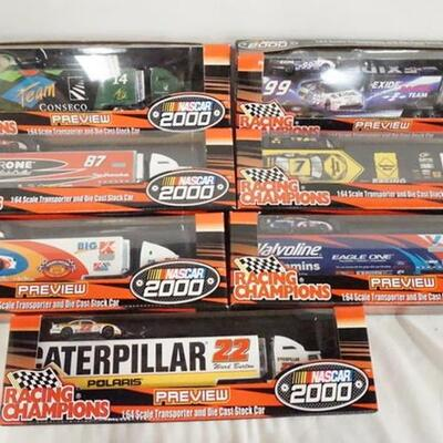1068LOT OF SEVEN RACING CHAMPIONS NASCAR 2000 1:64 SCALE MODEL CAR/TRUCK SETS. ALL COME IN ORIGINAL BOXES.