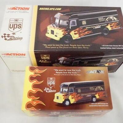 1048LOT OF TWO ACTION COLLECTABLES LIMITED EDITION NASCAR UPS TRUCKS. ONE TRUCK IS 1:32 SCALE THE OTHER IS 1:64 SCALE, BOTH COME IN...