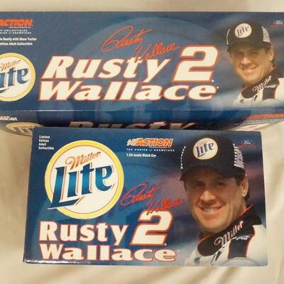 1047LOT OF TWO LIMITED EDITION RUSTY WALLACE NASCAR ACTION COLLECTABLES MODELS. LOT INCLUDES A 1:64 SCALE DUALLY W/ SHOW TRAILER IN A...