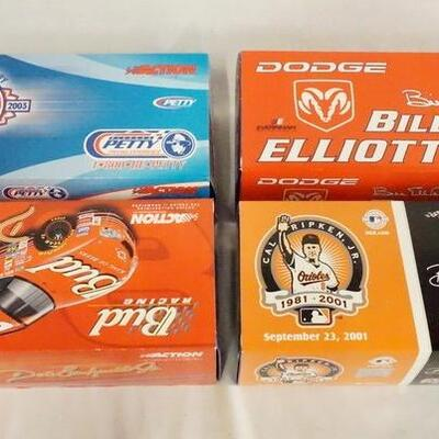 1065LOT OF FOUR ACTION COLLECTABLES LIMITED EDITION NASCAR 1:24 SCALE MODEL CARS. ALL COME W/ ORIGINAL BOXES.