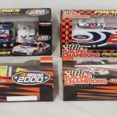 1067LOT OF FOUR RACING CHAMPIONS NASCAR 2000 1:64 SCALE MODEL CAR/TRUCK SETS. ALL COME IN ORIGINAL BOXES.