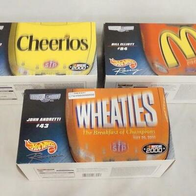 1049LOT OF THREE HOT WHEELS *CREWS CHOICE* NASCAR 1:24 SCALE MODEL CARS IN ORIGINAL BOXES.