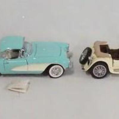 1021LOT OF FOUR FRANKLIN MINT PRECISION 1:24 SCALE DIE CAST MODEL CARS. LOT INCLUDES A 1957 CHEVROLET BELAIR, A 1956 CORVETTE, A 1938...