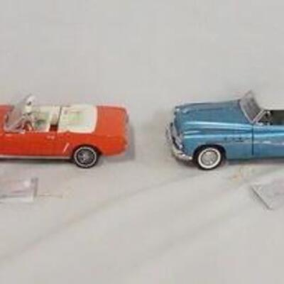 1037LOT OF FOUR FRANKLIN MINT 1:24 SCALE DIE CAST MODEL CARS. LOT INCLUDES A 1925 HISPANO-SUIZA KELLNER, A 1964 1/2 MUSTANG, A 1949...