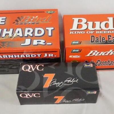 1050LOT OF THREE REVELL NASCAR DIE CAST MODEL CARS. LOT INCLUDES TWO LIMITED EDITION DALE ERNHARDT JR. MODELS 1:18 & 1:24 SCALE. ALL...