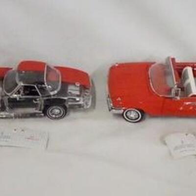 1039LOT OF FOUR FRANKLIN MINT 1:24 SCALE DIE CAST CHEVROLET MODEL CARS. LOT INCLUDES A 1963 CORVETTE, A 1967 CORVETTE, A 1960 IMPALA...