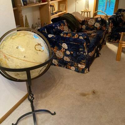 floor model globe and floral sofa