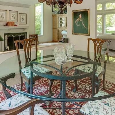 Round bevelled glass with wrought iron table and 6 x chippendale chairs
