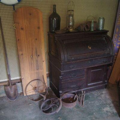 Garage loaded with rough antiques.
